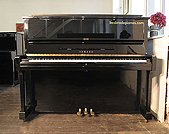 Piano for sale. A secondhand, Yamaha U1A upright piano with a black case and polyester finish.