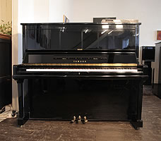 A 1991, Yamaha U30A upright piano with a black case and polyester finish. Piano features a fitted Disklavier MX100 player system