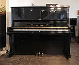 Piano for sale.  1991, Yamaha U30A upright piano with a black case and polyester finish. Piano features a fitted Disklavier MX100 player system