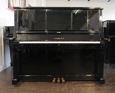 A hand-built, 1980, Yamaha YUA upright piano with a black case and polyester finish