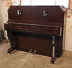 Piano for sale. A Barker upright piano with an Art Deco style, mahogany case. Cabinet features strong angular styling and chrome fittings.
