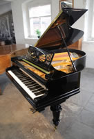 A restored, 1924, Bechstein Model A1 grand piano with a black case and turned, facetted legs