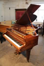 A 1920's, Bechstein Model L grand piano with a mahogany case, open-work music desk and square, tapered legs