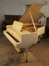 Piano for sale. A 1926, Bluthner Grand Piano For Sale with a Satin, Ivory Case and Square, Tapered Legs.