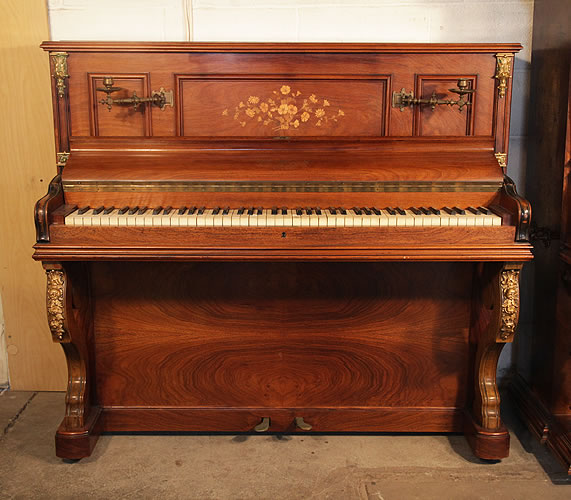 Bord upright piano with a mirrored, rosewood case. Cabinet features floral inlaid panels and  ormolu mounts