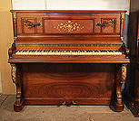 Piano for sale. A Bord upright piano with a mirrored, rosewood case. Cabinet features floral inlaid panels and ormolu mounts.