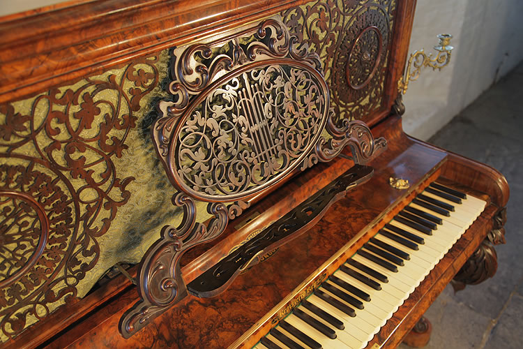 Burling & Burling ornate music desk, is an integral part of the fretwork front panel and can be pulled out to rest sheet music