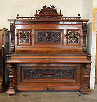Antique, Gabel upright piano with an ornately carved, Neoclassical style, walnut case