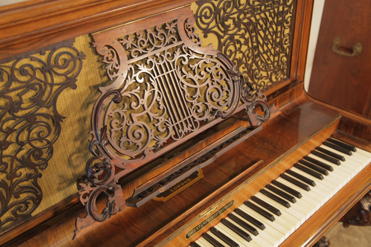 Kirkman upright piano with an ornate music desk that extends from the fretwork panel