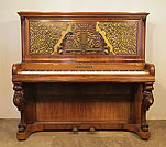 Piano for sale. A Kirkman upright piano with a rosewood case. Cabinet features an ornate fretwork front panel and carved, cabriole legs
