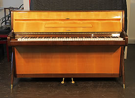 A Sauter upright piano with a Mid Century Modern style case in contrasting maple and walnut