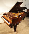 An 1880, Steinway Centennial Style 4 concert grand piano with a rosewood case, filigree music desk and turned, fluted legs.