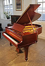 Piano for sale. A 1926, Steinway Model M grand piano with a mahogany case and spade legs.