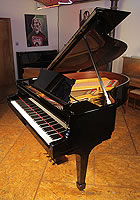 A rebuilt 1926, Steinway Model O grand piano with a black case and spade legs.