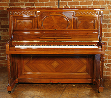 A rebuilt, 1912, Steinway Vertegrand Upright Piano For Sale with a Quartered, Walnut Case and Fluted, Sheraton Style Legs. Cabinet Features Ornate Carvings of Strapwork and Beading.