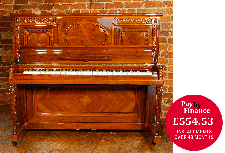 Steinway Upright Piano For Sale with a Quartered, Walnut Case with Ornate Carvings