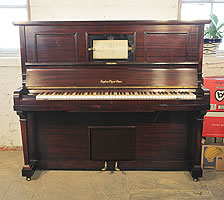A fully functioning Angelus upright pianola with a mahogany case. Comes with over 180 player rolls. Can be played as a piano or pianola