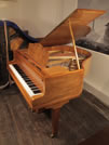 Piano for sale. A  Bluthner Baby Grand Piano For Sale with a Walnut Case and Spade Legs.