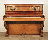 Piano for sale. Antique, Bord Upright Piano For Sale with a Quartered, Walnut Case with Carved Accents and Ornate Brass Candlesticks