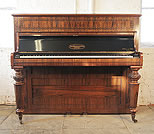 Piano for sale. An 1880, Broadwood cottage upright piano with a rosewood case. Cabinet features fretwork detail on the front panel and carved, facetted legs