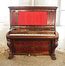 Piano for sale. A Collard and Collard upright piano with a rosewood case. Cabinet features ornate, filigree panels with red silk backing and carved, cabriole legs.