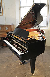 A Kawai GM-10K baby grand piano with a black case and square, tapered legs