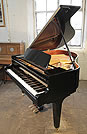 Piano for sale. A Kawai GM-10K baby grand piano with a black case and square, tapered legs