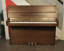 A 1990, Kemble upright piano with a mahogany case. Piano has a Langer 100 action and three pedals