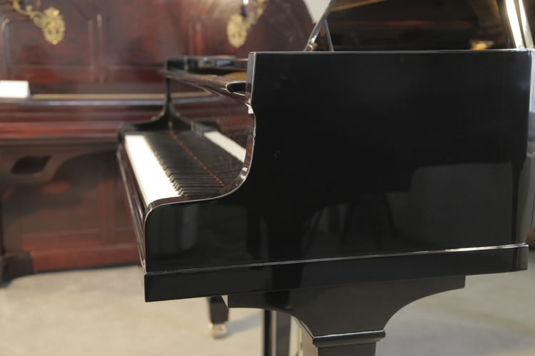 Miki Model 2 Grand Piano For Sale With A Black Case And