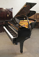 A Miki Model 2 grand piano for sale with a black case and spade legs.