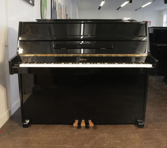 Opus upright Piano for sale with a black case.