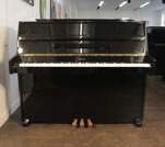 Piano for sale. An Opus upright piano with a black case. Piano has a seven octave keyboard.