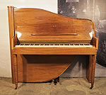 Piano for sale. A 1975, Rippen upright grand piano with an Art-Deco style walnut case. Cabinet features telescopic style legs. The cabinet follows the sinuous line of the internal grand piano frame