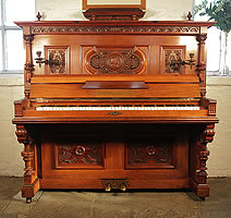 Antique, Roth & Tunius upright piano with an ornately carved, Neoclassical style, walnut case