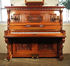 Piano for sale. Antique, Roth & Tunius upright piano with an ornately carved, Neoclassical style, walnut case