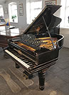 Piano for sale. An unrestored, 1898, Steinway Model A grand piano for sale with a black case, filigree music desk and fluted, barrel legs