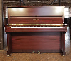 A 1980, Steinway Model V upright piano with a mahogany case.