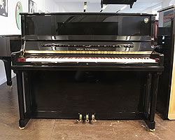 Steinberg Model AT-K23 upright piano with a black case and brass fittings
