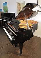 A brand new, Steinberg WS-T166 grand piano with a black case and brass fittings. The instrument features the best in German design