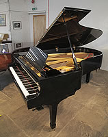 A 1971, Yamaha C7 grand piano for sale with a black case and spade legs.