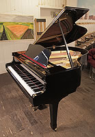 A 1975, Yamaha G2 grand piano for sale with a black case and spade legs. Piano has some scratches to the polyester on cabinet which is reflected in the price.