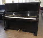 Piano for sale. A 1943, Bechstein model 8 upright piano with a polished, black case