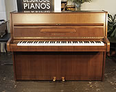 A 1982, Bechstein upright piano with a satin, mahogany case