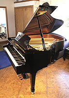 A Boston GP178 II grand piano with a black case and spade legs. Keyboard lid features a slow fall mechanism.