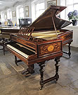 Piano for sale. An 1885, Broadwood grand piano for sale with a Neoclassical style, inlaid flame mahogany case and gate legs