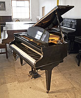 A 1965, Challen baby grand piano for sale with a black case and square, tapered legs