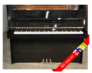 A 1984, Kawai CE-7N upright piano with a re-polyestered, black case and brass fittings