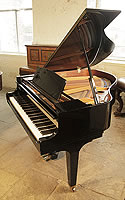 A 1987, Kawai GE-1 baby grand piano for sale with a black case and square, tapered legs