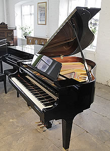 A Kawai GM10 baby grand piano for sale with a black case and polyester finish