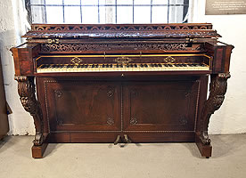 An 1844, Pape console upright piano with a Rococo style, rosewood case. Cabinet features carvings of shells, hibiscus and scrolling acanthus and carved, cabriole legs with scroll feet.s